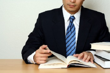 Businessman reading a book