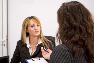 young woman being interviewed for a job